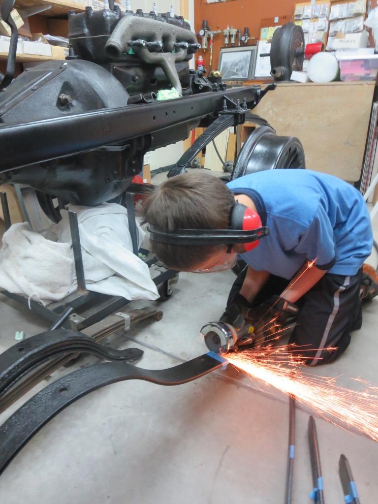 Aaron cutting rear springs to proper width.jpg